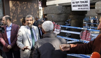 "Kurdish lawyer and President of Diyarbakir Bar Tahir Elci (C) speaks just moments before he is shot dead on November 28, 2015 in Diyarbakir. The leading Kurdish lawyer was shot dead in southeast Turkey on November 28 after unknown attackers opened fire on a gathering in the mainly Kurdish province of Diyarbakir, triggering a shootout with police, hospital sources and witnesses said. Tahir Elci, head of the bar in Diyarbakir, who had been detained in October for alleged ""terrorist propaganda"", died of gunshot wounds to the head, hospital sources told AFP."