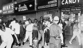 Demonstrators march on 125th Street near Seventh Ave. during the Harlem Riots of 1964.
