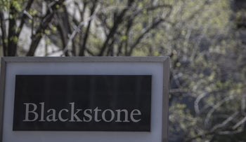 Signage is displayed outside Blackstone Group LP headquarters in New York, U.S., on Friday, April 14, 2017.