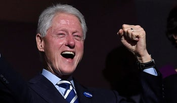 Bill Clinton sports a pin spelling out the name of his wife in Hebrew lettering.
