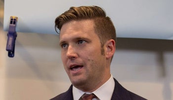 White nationalist Richard Spencer speaks to select media in his office space on August 14, 2017 in Alexandria, Virginia.