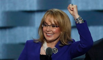 Former U.S. Representative Gabby Giffords pumps her fist as she speaks on the third night at the Democratic National Convention in Philadelphia, Pennsylvania, U.S., July 27, 2016.