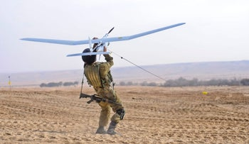 An Israeli soldier with a Sky Rider drone, 2011.