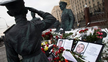 Flowers outside Russian Army General Staff headquarters in Moscow, Russia, Thursday, Nov. 26, 2015.