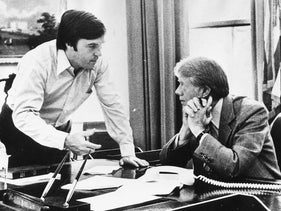 Hamilton Jordan, left, speaking with President Jimmy Carter at the White House, July 19, 1979.