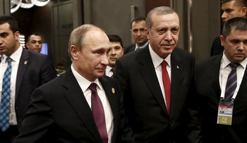 Turkish President Tayyip Erdogan walks with his Russian counterpart Vladimir Putin prior to their meeting at G20 summit, November 16, 2015.