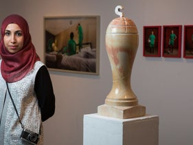 """Bezalel Academy graduate Safaa Khatib and her final project, entitled """"Palestine World Cup – 2034,"""" on display at a student exhibition, July 2016."""