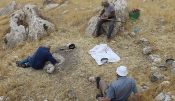 Testing how Natufian man used the 12,500-year old mortars carved into the bedrock at Huzuk Musa: They could be used to process barley into flour.