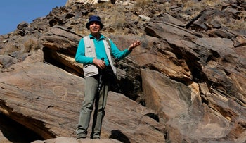 Iranian archeologist Mohammed Naserifard displays ancient engravings in the hills outside the town of Khomein in central Iran on October 24, 2016.