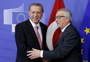 European Commission President Jean-Claude Juncker welcomes Turkey's President Tayyip Erdogan at the EU Commission headquarters in Brussels, Belgium, October 5, 2015.