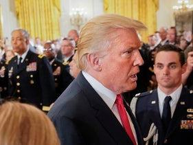 Generals lead unprecedented revolt against Trump, their commander in chief. Pictured: Trump departs after bestowing the Medal of Honor to retired Army medic James McCloughan, July 31, 2017.