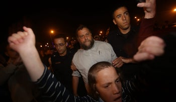 Four Lehava protesters at night in Jerusalem, among them their leader, Benzi Gopstein, back center, October 8, 2015.