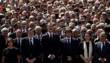 Among other leaders and thousands of Spaniards, Spanish Prime Minister Mariano Rajoy and President of the Generalitat of Catalonia Carles Puigdemont observe a minute of silence the day after a van crashed into pedestrians at Las Ramblas in Barcelona, Spain on August 18, 2017.