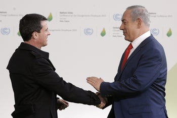 Prime Minister Benjamin Netanyahu (R) is greeted by France's Prime Minister Manuel Valls as he arrives for the COP21 United Nations Climate Change Conference on November 30, 2015