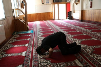 A man prays at a mosque where imam Abdelbaki Es Satty preached in Ripoll, north of Barcelona, Spain, August 19, 2017.