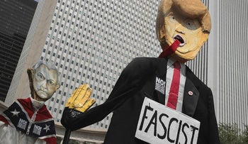 Demonstrators protesting the alt-right movement and mourning the victims of yesterdays rally in Charlottesville, Virginia carry puppets of President Donald Trump and U.S. Attorney General Jeff Sessionson August 13, 2017 in Chicago, Illinois