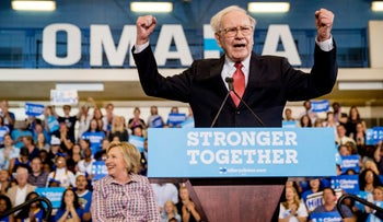 Warren Buffett cheers at a rally in Omaha, Neb. while Democratic presidential candidate Hillary Clinton smiles at the crowd on Aug. 1, 2016.