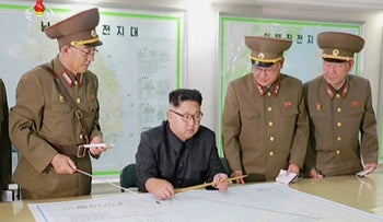 A still image from a broadcast by North Korea's KRT shows North Korean leader Kim Jong Un receiving a briefing in Pyongyang, August 15, 2017.