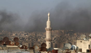 A general view shows rising smoke from burning tyres, which activists said are used to create smoke cover from warplanes, in Aleppo, Syria August 1, 2016.
