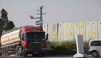 A gas tanker approaching the Kerem Shalom crossing into the Gaza Strip, from Israel. The transport of certain types of construction-related goods into the Strip is illegal.