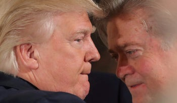 Trump talks to chief strategist Steve Bannon during a swearing in ceremony for senior staff at the White House in Washington, U.S. January 22, 2017.