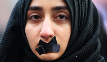 A Turkish student cries during a protest to show solidarity with trapped citizens of Aleppo, Syria, in Sarajevo, Bosnia and Herzegovina December 14, 2016