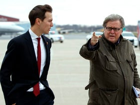 Jared Kushner, Donald Trump's son-in-law, walks with Trump's Chief Strategist Steve Bannon at Indianapolis International Airport, Indiana, December 1, 2016.