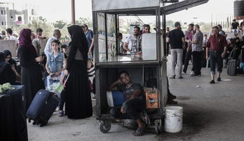 Palestinians wait for travel permits to cross into Egypt through the Rafah border crossing, August 16, 2017.