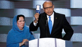 Khizr Khan holds up a copy of the Constitution of the United States as his wife listens at the Democratic National Convention in Philadelphia, Pennsylvania on July 28, 2016.