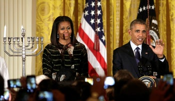 Michelle and Barack Obama at a Hanukkah candle lighting ceremony this week.
