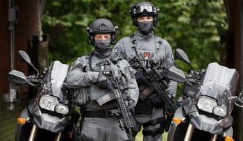 British counter terrorism officers pose in London on August 3, 2016.
