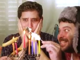 Screenshot from ad shows an uncomfortable ashkenazi man embraced by two colorfully dressed Mizrahi men.
