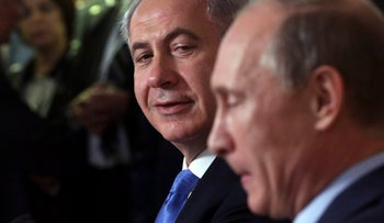 Exchanging sweet nothing-muches? Israeli premier Benjamin Netanyahu, left, with Russian leader Vladiir Putin, at the Bocharov Ruchei state residence in Sochi, May 2013.