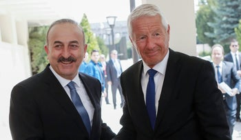 Council of Europe head Thorbjorn Jagland (left) meets with Turkish Foreign Minister Mevlut Cavusoglu in Ankara, August 3, 2016.
