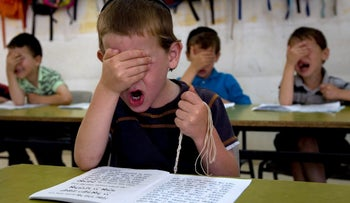 Haredi children in reading class at the Kehilot Yaacov Torah School for boys in Ramot, Jerusalem, Israel. How to destroy Israel's future: Don't teach them math, English or other core curriculum subjects.