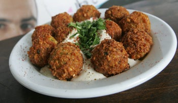 A plate of falafel balls with tahini.