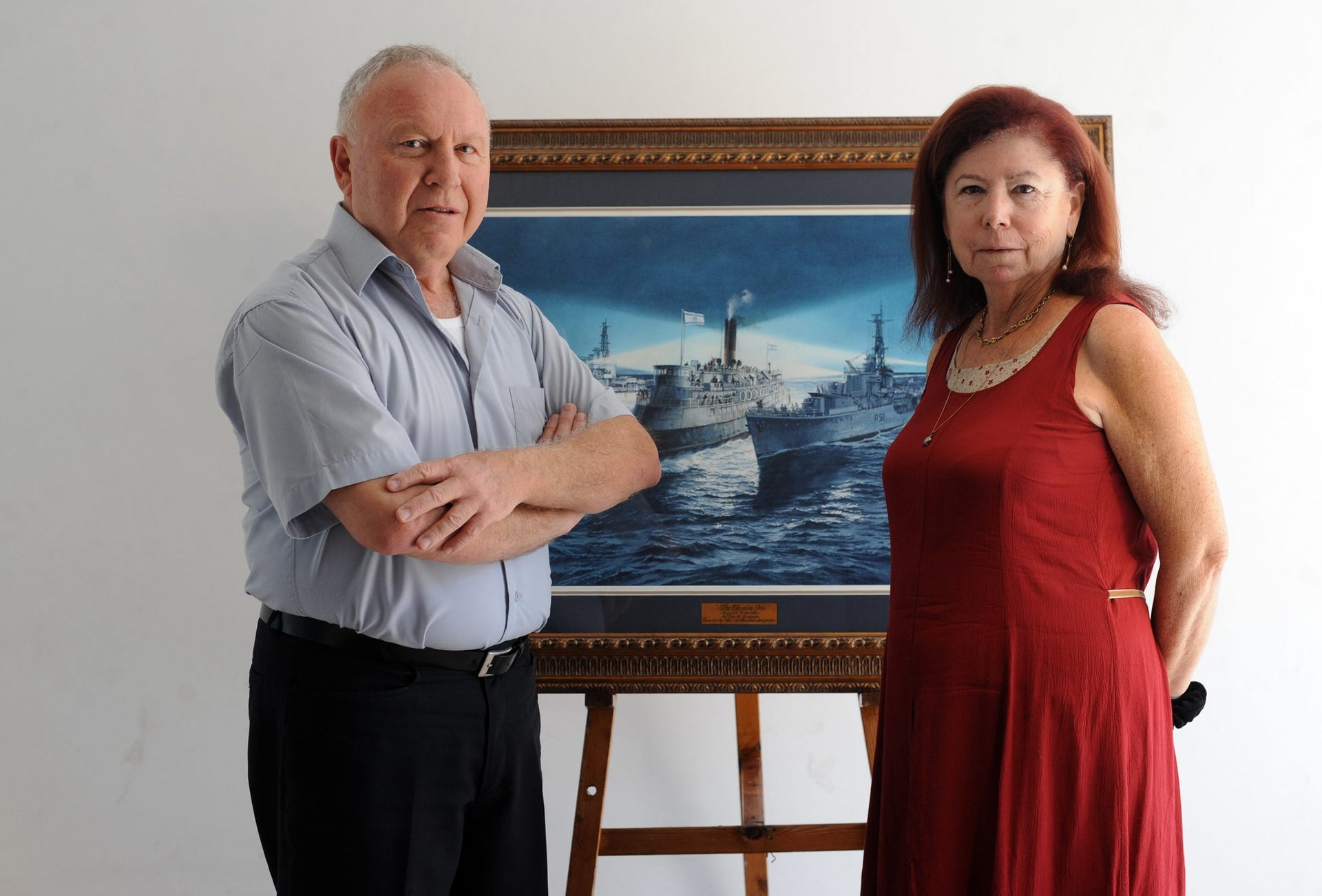 Zvi Hatkevitz (L) and Tzipi Portnoy, both 'children of the Exodus,' stand in front of a drawing of the ship, August 23, 2017.