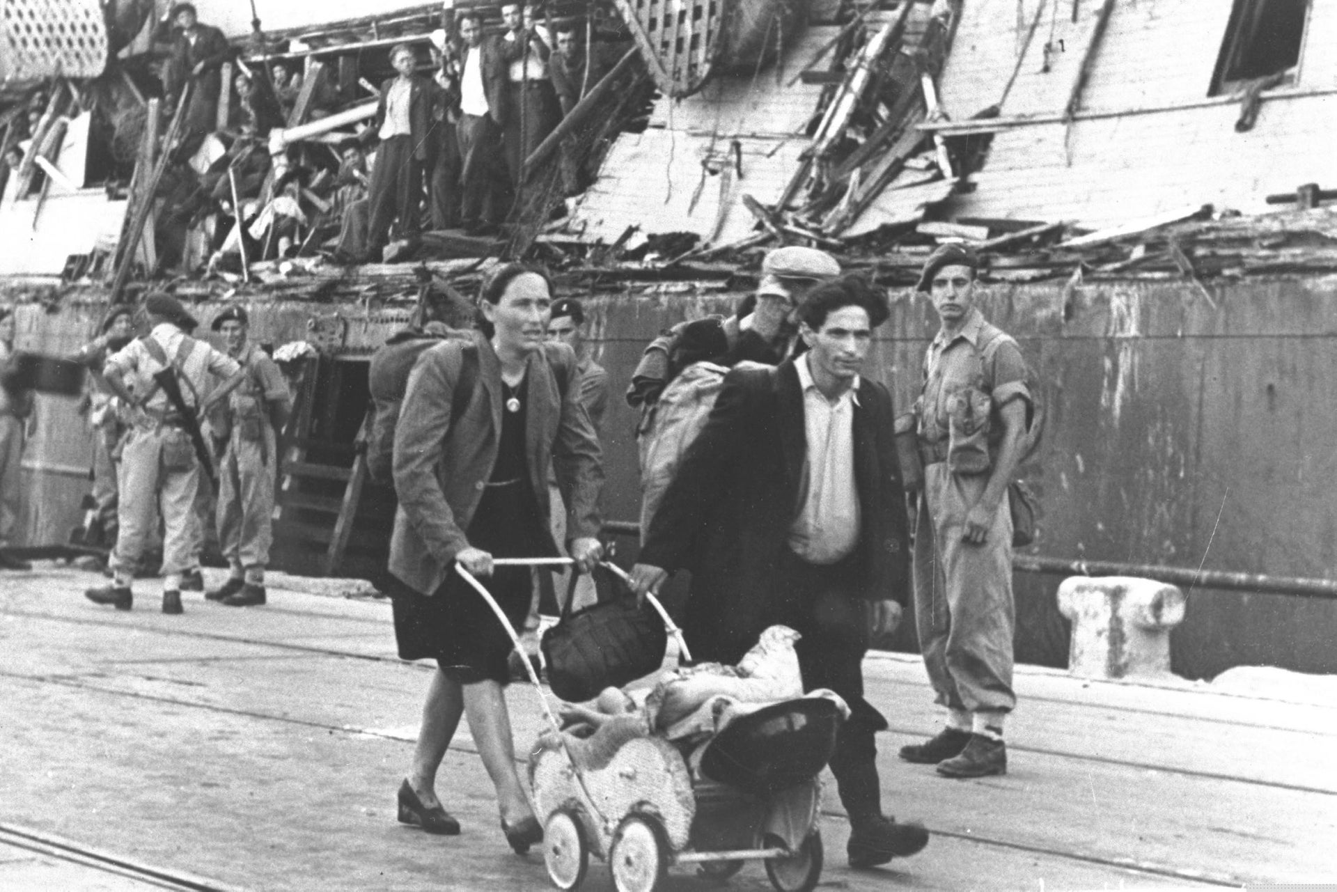 A family of illegal Jewish immigrants leave the Exodus in Haifa to be deported back to Europe, 1947.