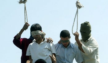 Illustration: Two teenagers are set to be publicly hanged, Mashhad, Iran, July 19, 2005.