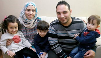 Syrian refugee Bashar al Jaddou, his wife Maryam and their children Maria, Hasan and Mohammad at their apartment in Dallas, Texas, November 29, 2015.
