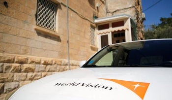 The logo of U.S.-based Christian charity World Vision on a car parked outside their offices in Jerusalem on Aug 4, 2016.