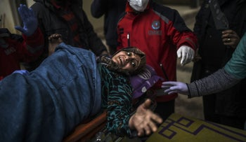 An injured Syrian woman from Aleppo is transported across the border to a hospital in Turkey, December 16, 2016.