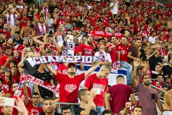 Hapoel Be'er Sheva fans celebrating Wednesday's Champions League win over Olympiacos.