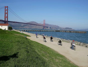 In this November 25, 2014 file photo, a group of people on rental bicycles ride past Crissy Field toward the Golden Gate Bridge in San Francisco.