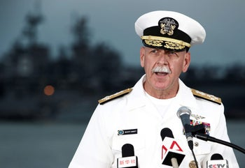 Admiral Scott Swift, commander of the U.S. Pacific Fleet, speaking at a news conference near the damaged USS John McCain and the USS America at Changi Naval Base, Singapore, August 22, 2017.