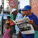 A man reads an issue of Granma newspaper with a front page that displays a picture of Cuban leader Fidel Castro, Havana, Cuba, August 13, 2016.