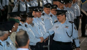 Incoming police commissioner Roni Alsheich greets his senior officers after being sworn into office.