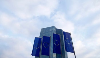 European Union (EU) flags fly in front of the European Central Bank (ECB) headquarters in Frankfurt, Germany, December 3, 2015.