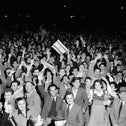 People gather in the streets of Tel Aviv after radio broadcasts announce UN plan for partition of Palestine and the new Jewish state, November 30, 1947.