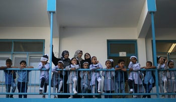 Palestinian schoolchildren and teachers stand outside their classrooms on the first day of the school year at a UN-run school in Deir al-Balah, Gaza Strip, August 23, 2017.
